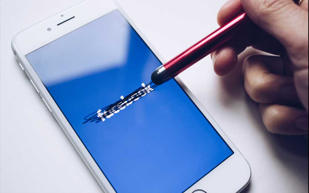 Facebook app on phone being erased by stylus - blockchain data privacy