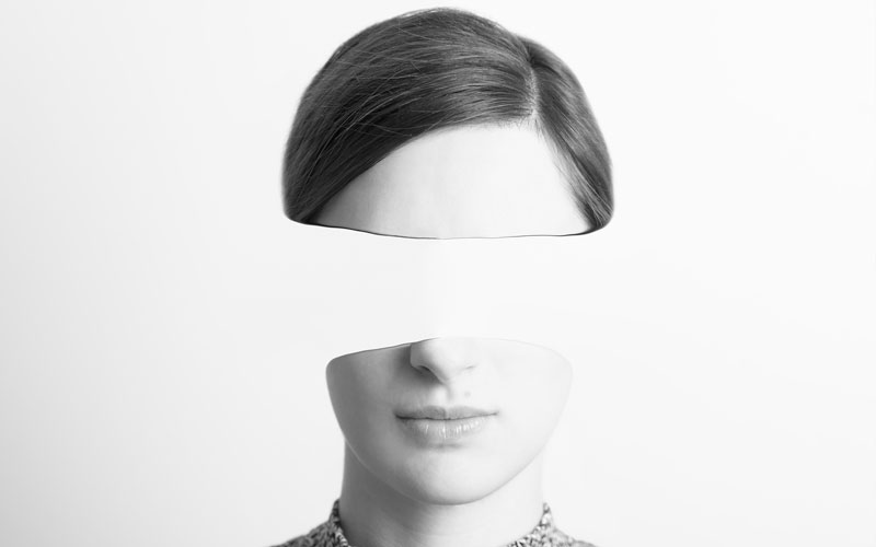 Woman with identity stripped from her face